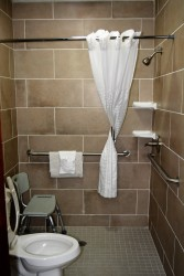 Accessible King featuring roll in shower - Modern tile work enhances our roll in shower